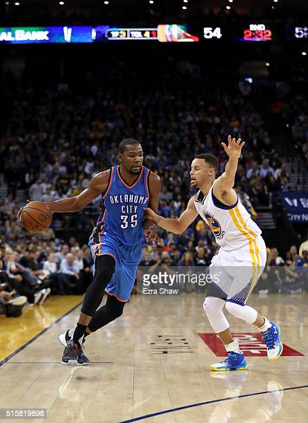 Kevin Durant of the Oklahoma City Thunder is guarded by Stephen Curry of the Golden State Warriors at ORACLE Arena on March 3 2016 in Oakland...