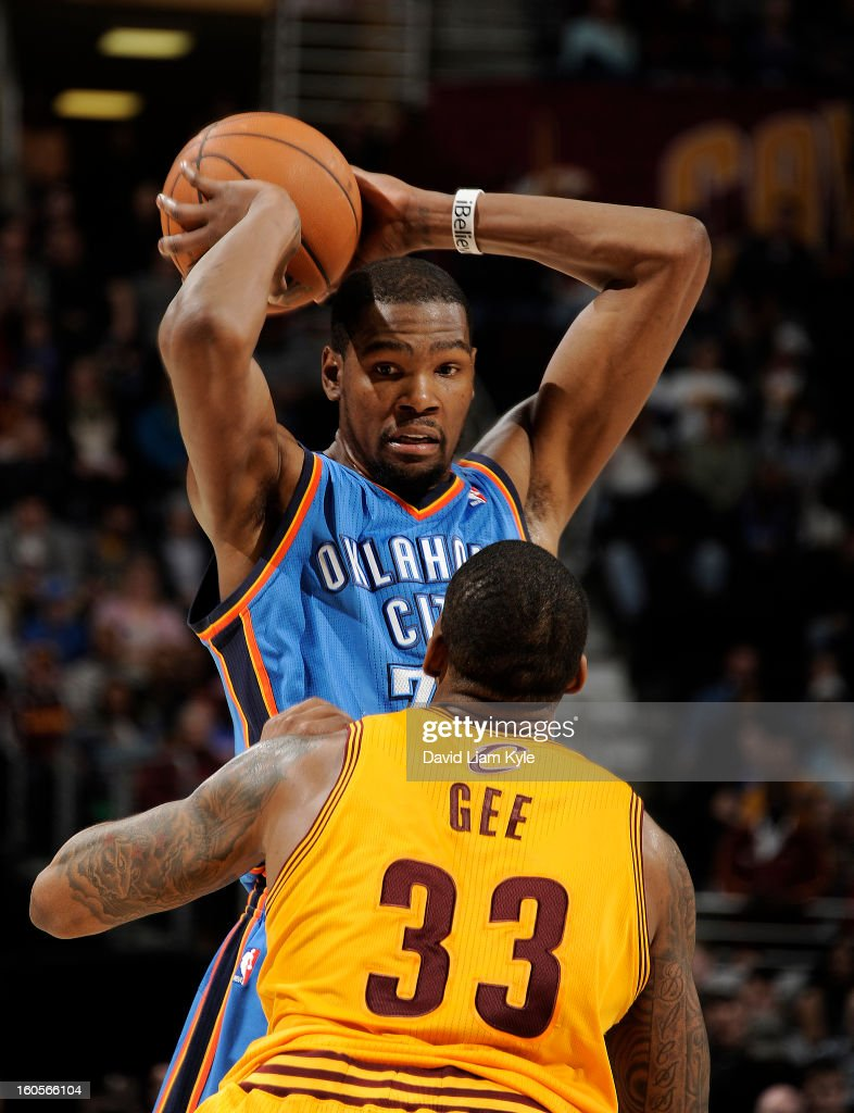 Kevin Durant #35 of the Oklahoma City Thunder keeps the ball out of reach of Alonzo Gee #33 of the Cleveland Cavaliers at The Quicken Loans Arena on February 2, 2013 in Cleveland, Ohio.
