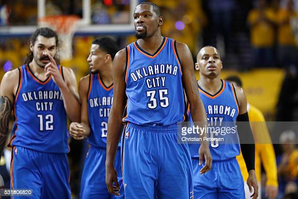 Kevin Durant of the Oklahoma City Thunder leads his team on the court during game one of the NBA Western Conference Final against the Golden State...