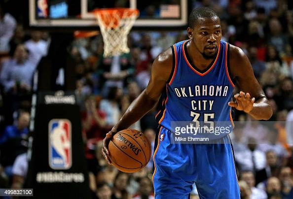 Kevin Durant of the Oklahoma City Thunder looks on during a game against the Miami Heat at American Airlines Arena on December 3 2015 in Miami...