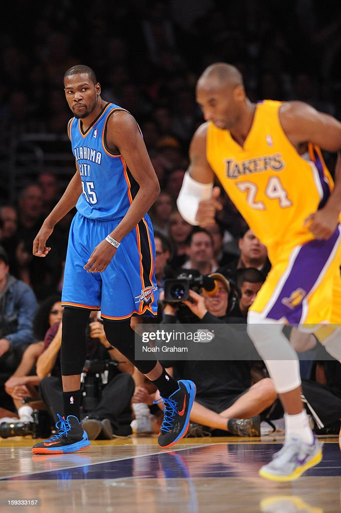 Kevin Durant #35 of the Oklahoma City Thunder looks on while Kobe Bryant #24 of the Los Angeles Lakers runs down the court at Staples Center on January 11, 2013 in Los Angeles, California.
