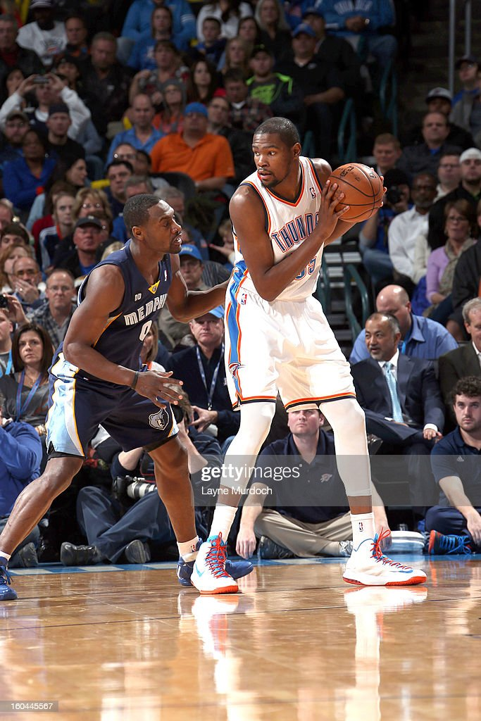 Kevin Durant #35 of the Oklahoma City Thunder looks to pass the ball against the Memphis Grizzlies during an NBA game on January 31, 2013 at the Chesapeake Energy Arena in Oklahoma City, Oklahoma.
