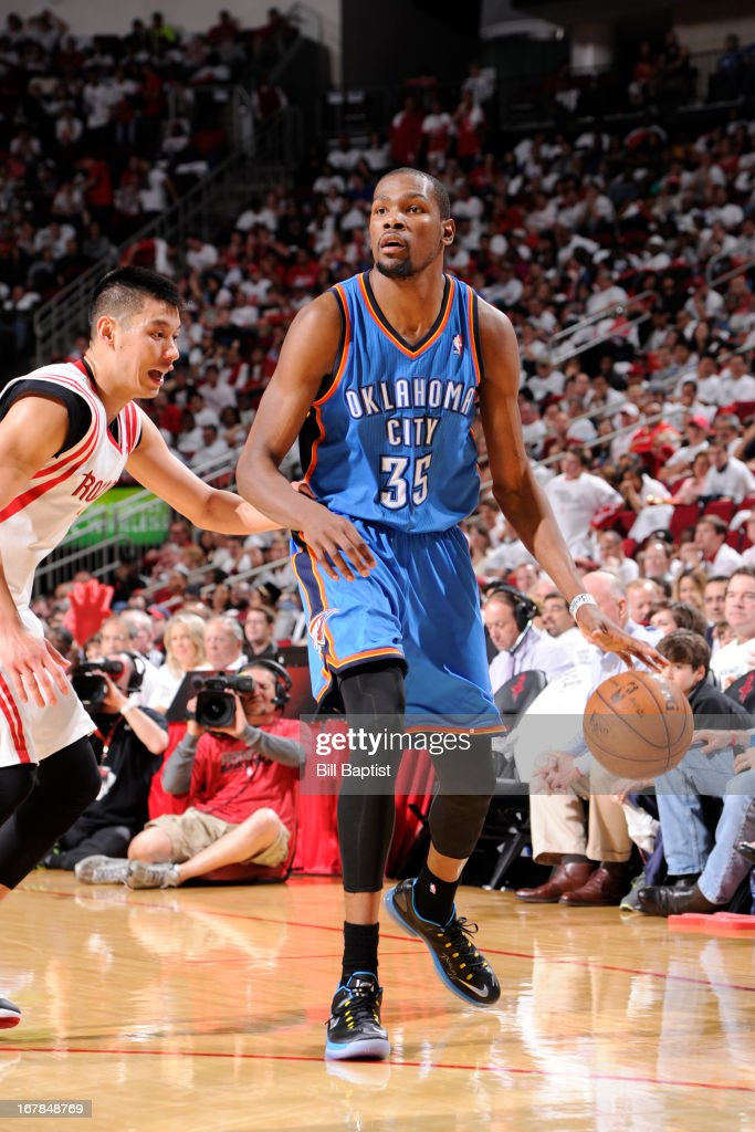 <a gi-track='captionPersonalityLinkClicked' href=/galleries/search?phrase=Kevin+Durant&family=editorial&specificpeople=3847329 ng-click='$event.stopPropagation()'>Kevin Durant</a> #35 of the Oklahoma City Thunder looks to pass the ball against the Houston Rockets in Game Three of the Western Conference Quarterfinals during the 2013 NBA Playoffs on April 27, 2013 at the Toyota Center in Houston, Texas.