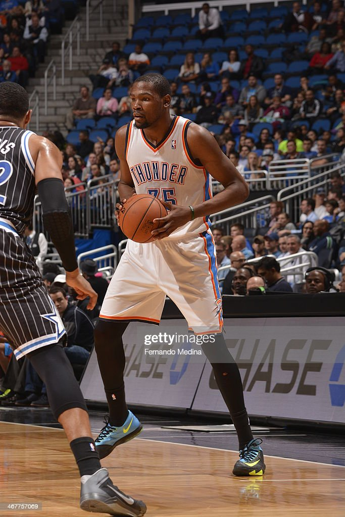 <a gi-track='captionPersonalityLinkClicked' href=/galleries/search?phrase=Kevin+Durant&family=editorial&specificpeople=3847329 ng-click='$event.stopPropagation()'>Kevin Durant</a> #35 of the Oklahoma City Thunder looks to pass the ball against the Orlando Magic during the game on February 7, 2014 at Amway Center in Orlando, Florida.