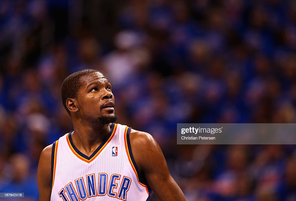 <a gi-track='captionPersonalityLinkClicked' href=/galleries/search?phrase=Kevin+Durant&family=editorial&specificpeople=3847329 ng-click='$event.stopPropagation()'>Kevin Durant</a> #35 of the Oklahoma City Thunder looks up to the video board during Game Five of the Western Conference Quarterfinals of the 2013 NBA Playoffs against the Houston Rockets at Chesapeake Energy Arena on May 1, 2013 in Oklahoma City, Oklahoma.