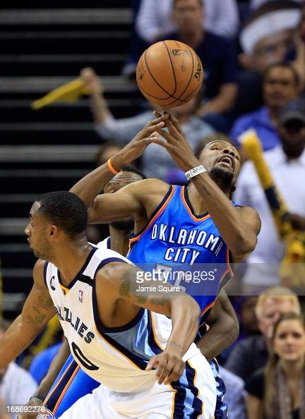 Kevin Durant of the Oklahoma City Thunder loses the ball as Quincy Pondexter of the Memphis Grizzlies defends during Game Four of the Western...