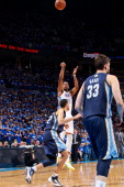 Kevin Durant of the Oklahoma City Thunder makes a goahead shot late in the fourth quarter leading to the team's victory against Tayshaun Prince of...