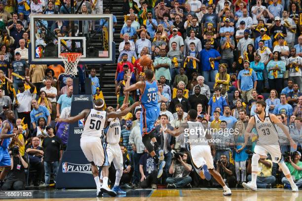 Kevin Durant of the Oklahoma City Thunder makes a layup to force overtime as time winds down in the fourth quarter against Mike Conley of the Memphis...