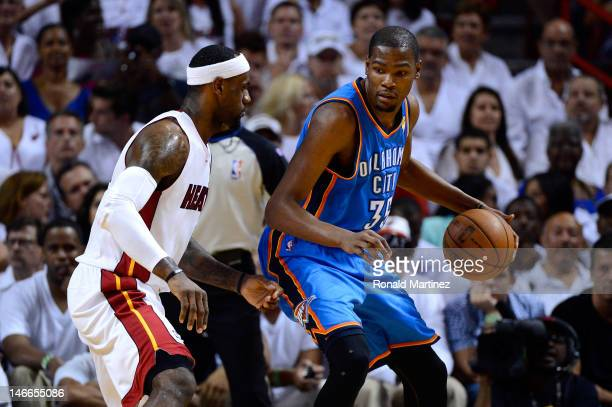 Kevin Durant of the Oklahoma City Thunder moves the ball in the post in the first quarter against LeBron James of the Miami Heat in Game Five of the...