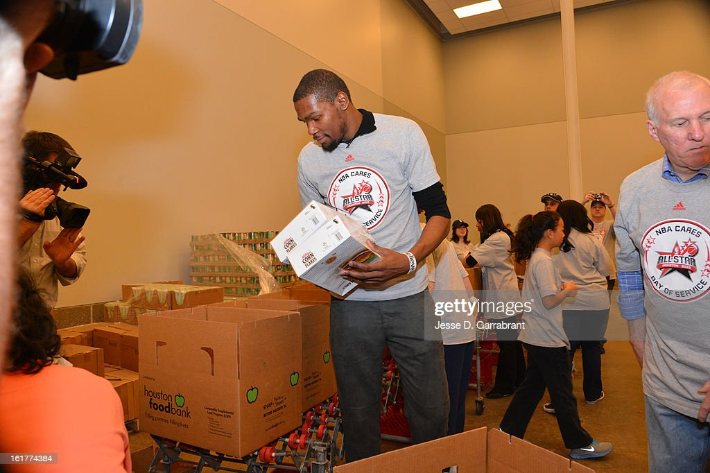 Kevin Durant #35 of the Oklahoma City Thunder participates at the 2013 NBA Cares Day of Service at the Food Bank on February 15, 2013 in Houston, Texas.