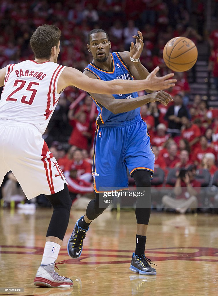 Kevin Durant (35) of the Oklahoma City Thunder passes by Chandler Parsons (25) of the Houston Rockets in the second half of their Western Conference playoff game game on Friday, May 3, 2013, in Houston, Texas.