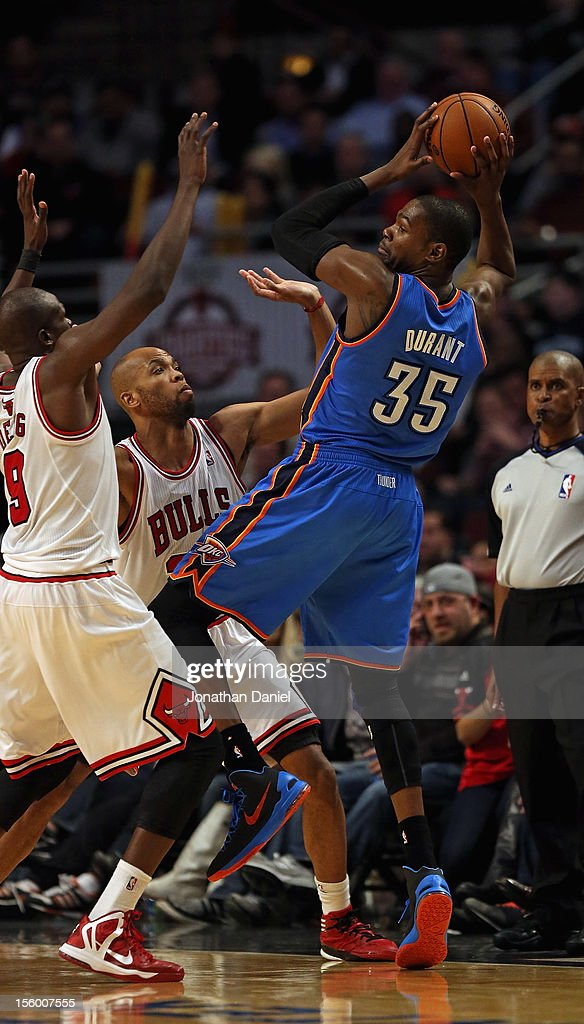 Kevin Durant #35 of the Oklahoma City Thunder passes over Loul Deng #9 (L) and Taj Gibson #22 of the Chicago Bulls at the United Center on November 8, 2012 in Chicago, Illinois. The Thunder defated the Bulls 97-91.