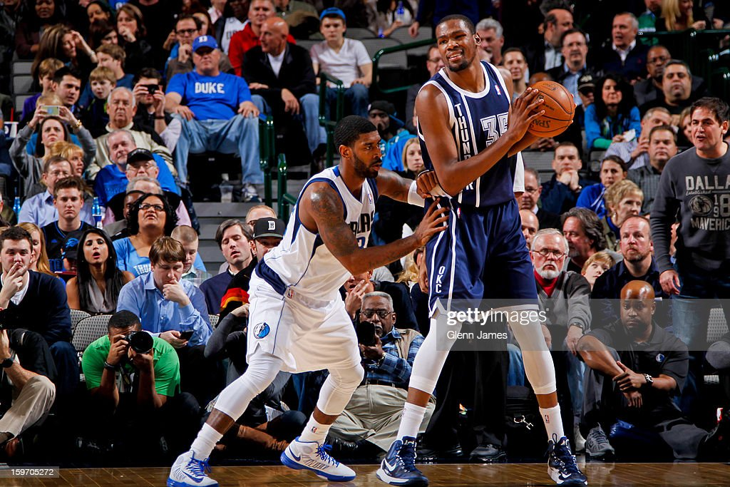 Kevin Durant #35 of the Oklahoma City Thunder posts up against O.J. Mayo #32 of the Dallas Mavericks on January 18, 2013 at the American Airlines Center in Dallas, Texas.