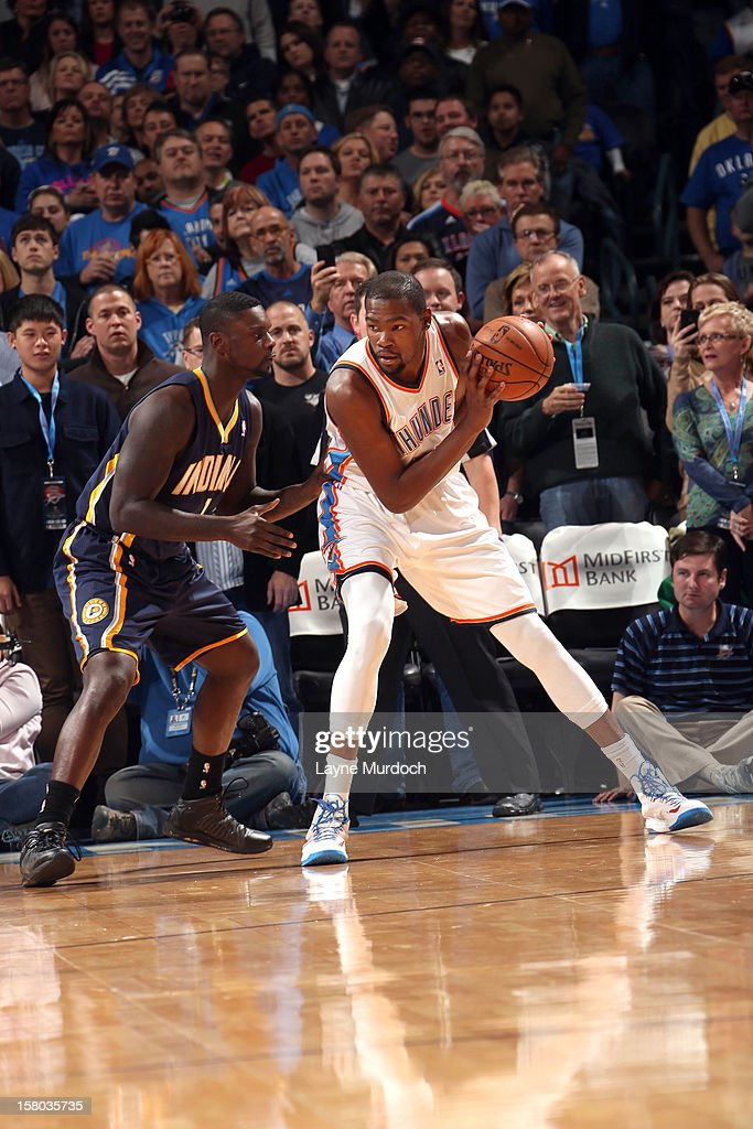 Kevin Durant #35 of the Oklahoma City Thunder protects the ball from Lance Stephenson #1 of the Indiana Pacers during the game between the Oklahoma City Thunder and the Indiana Pacers on December 9, 2012 at the Chesapeake Energy Arena in Oklahoma City, Oklahoma.