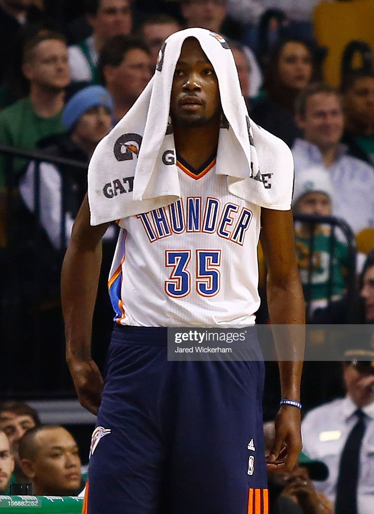 Kevin Durant #35 of the Oklahoma City Thunder puts a towel over his head while on the bench against the Boston Celtics during the game on November 23, 2012 at TD Garden in Boston, Massachusetts.