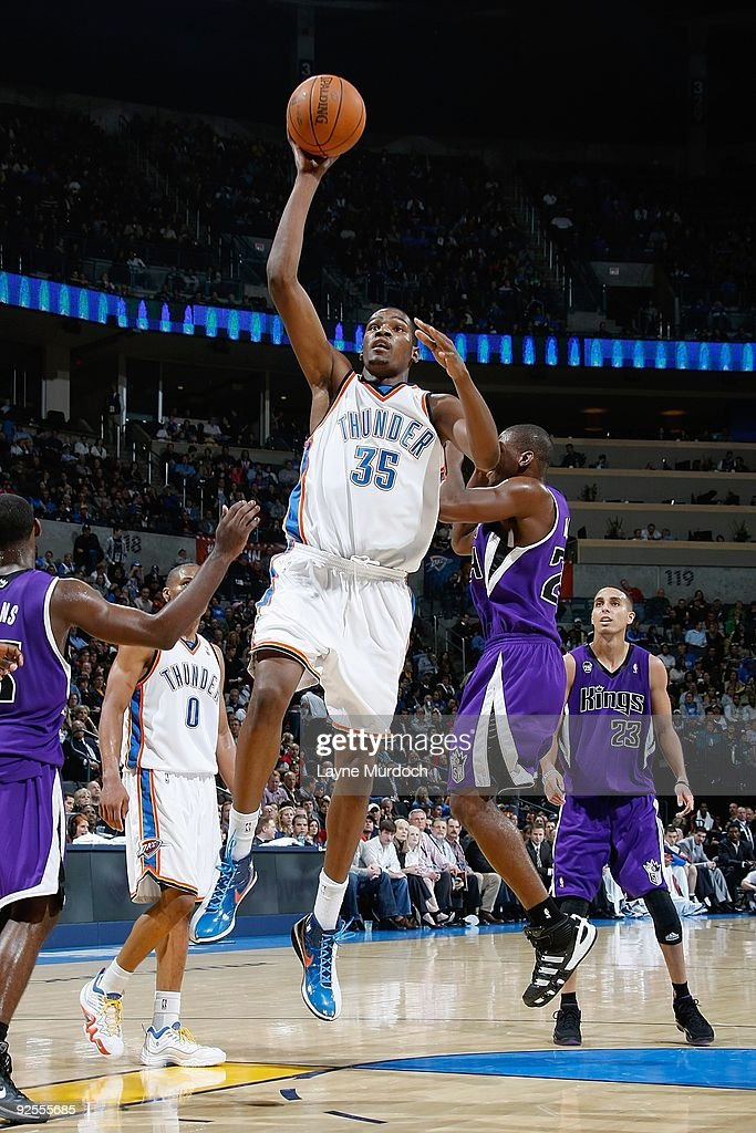 Kevin Durant of the Oklahoma City Thunder puts up a shot against Desmond Mason of the Sacramento Kings during the game on October 28 2009 at the Ford...
