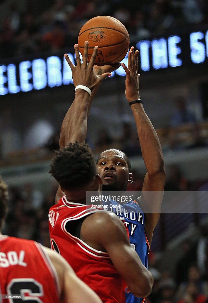 Kevin Durant #35 of the Oklahoma City Thunder puts up a shot over Jimmy Butler #21 of the Chicago Bulls on his way to a game-high 33 points at the United Center on November 5, 2015 in Chicago, Illinois. The Bulls defeated the Thunder 104-98. Note to User: User expressly acknowledges and agrees that, by downloading and or using the photograph, User is consenting to the terms and conditions of the Getty Images License Agreement.