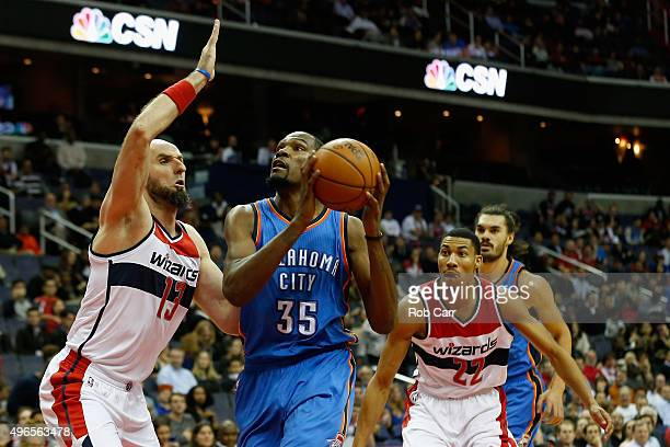 Kevin Durant of the Oklahoma City Thunder puts up a shot over Marcin Gortat of the Washington Wizards during the first half at Verizon Center on...
