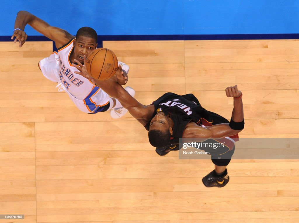 <a gi-track='captionPersonalityLinkClicked' href=/galleries/search?phrase=Kevin+Durant&family=editorial&specificpeople=3847329 ng-click='$event.stopPropagation()'>Kevin Durant</a> #35 of the Oklahoma City Thunder reached for the ball against <a gi-track='captionPersonalityLinkClicked' href=/galleries/search?phrase=Chris+Bosh&family=editorial&specificpeople=201574 ng-click='$event.stopPropagation()'>Chris Bosh</a> #1 of the Miami Heat during Game Two of the 2012 NBA Finals at Chesapeake Energy Arena on June 14, 2012 in Oklahoma City, Oklahoma.