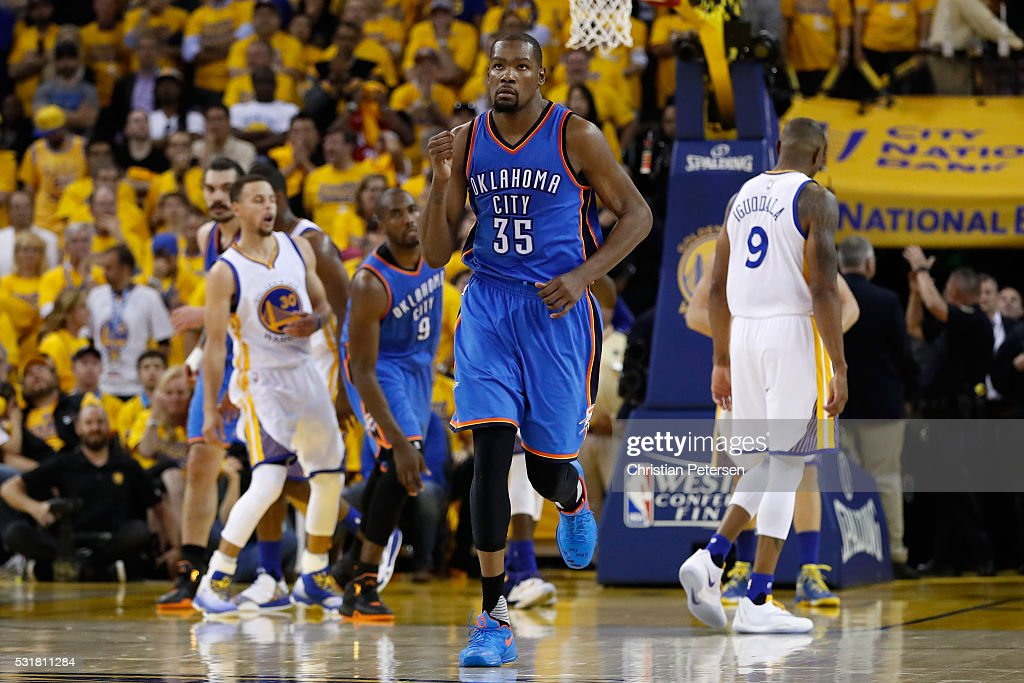 <a gi-track='captionPersonalityLinkClicked' href=/galleries/search?phrase=Kevin+Durant&family=editorial&specificpeople=3847329 ng-click='$event.stopPropagation()'>Kevin Durant</a> #35 of the Oklahoma City Thunder reacts after a basket in the fourth quarter against the Golden State Warriors during game one of the NBA Western Conference Final at ORACLE Arena on May 16, 2016 in Oakland, California.