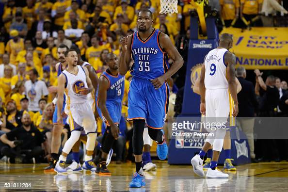 Kevin Durant of the Oklahoma City Thunder reacts after a basket in the fourth quarter against the Golden State Warriors during game one of the NBA...