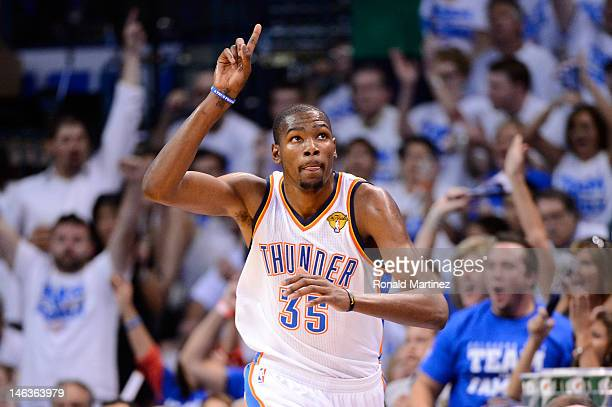 Kevin Durant of the Oklahoma City Thunder reacts after making a basket in the third quarter while taking on the Miami Heat in Game Two of the 2012...