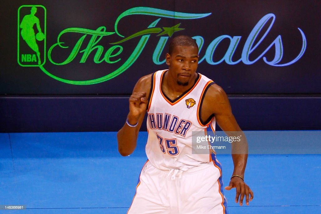 <a gi-track='captionPersonalityLinkClicked' href=/galleries/search?phrase=Kevin+Durant&family=editorial&specificpeople=3847329 ng-click='$event.stopPropagation()'>Kevin Durant</a> #35 of the Oklahoma City Thunder reacts after making a three-pointer late in the fourth quarter against the Miami Heat in Game Two of the 2012 NBA Finals at Chesapeake Energy Arena on June 14, 2012 in Oklahoma City, Oklahoma.
