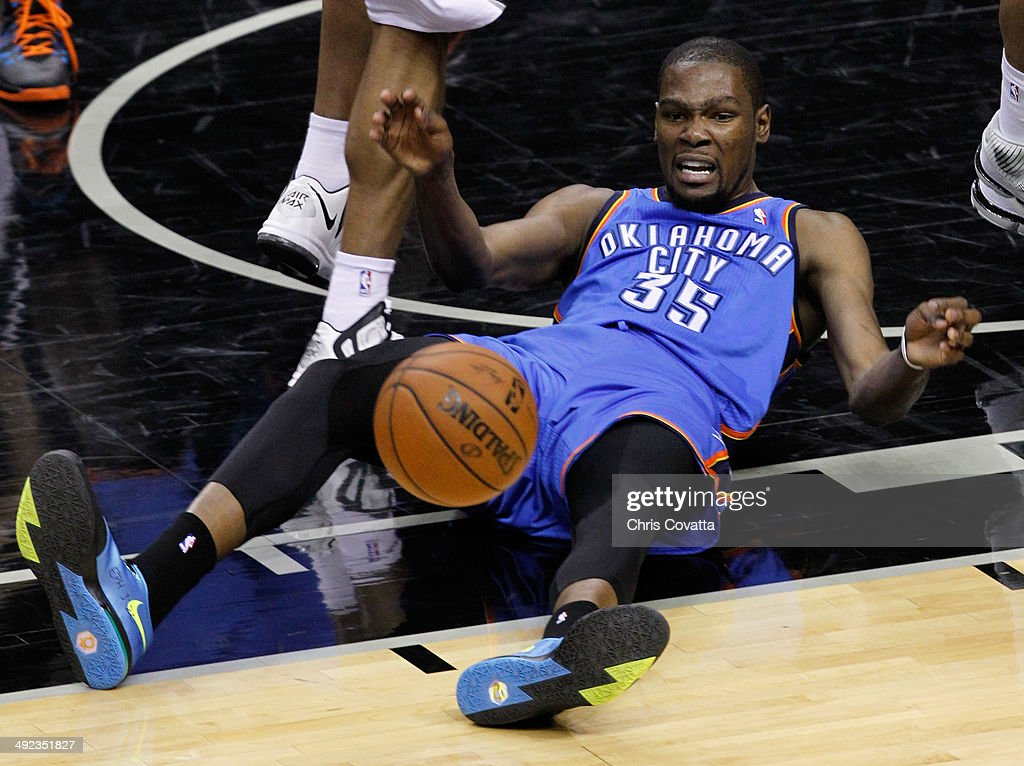 <a gi-track='captionPersonalityLinkClicked' href=/galleries/search?phrase=Kevin+Durant&family=editorial&specificpeople=3847329 ng-click='$event.stopPropagation()'>Kevin Durant</a> #35 of the Oklahoma City Thunder reacts in the first half while taking on the San Antonio Spurs in Game One of the Western Conference Finals during the 2014 NBA Playoffs at AT&T Center on May 19, 2014 in San Antonio, Texas.