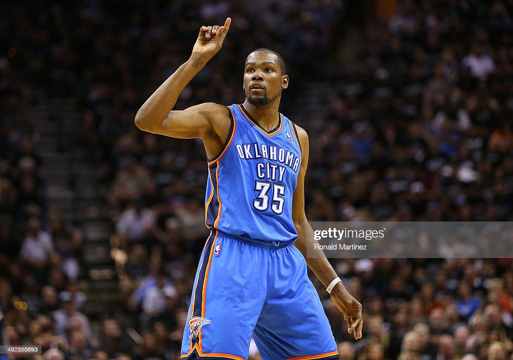 <a gi-track='captionPersonalityLinkClicked' href=/galleries/search?phrase=Kevin+Durant&family=editorial&specificpeople=3847329 ng-click='$event.stopPropagation()'>Kevin Durant</a> #35 of the Oklahoma City Thunder reacts in the second half while taking on the San Antonio Spurs in Game One of the Western Conference Finals during the 2014 NBA Playoffs at AT&T Center on May 19, 2014 in San Antonio, Texas.
