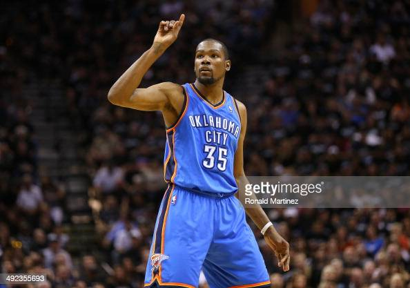 Kevin Durant of the Oklahoma City Thunder reacts in the second half while taking on the San Antonio Spurs in Game One of the Western Conference...