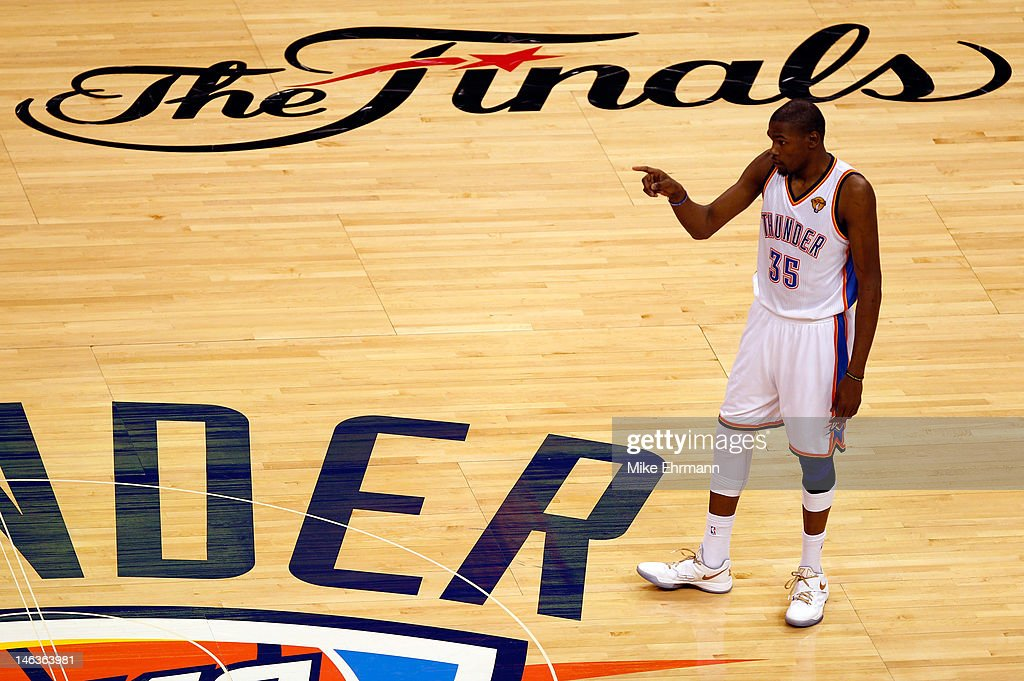<a gi-track='captionPersonalityLinkClicked' href=/galleries/search?phrase=Kevin+Durant&family=editorial&specificpeople=3847329 ng-click='$event.stopPropagation()'>Kevin Durant</a> #35 of the Oklahoma City Thunder reacts in the third quarter while taking on the Miami Heat in Game Two of the 2012 NBA Finals at Chesapeake Energy Arena on June 14, 2012 in Oklahoma City, Oklahoma.