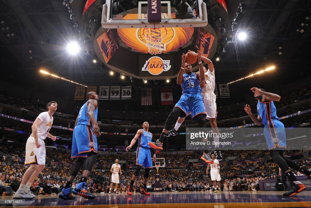 <a gi-track='captionPersonalityLinkClicked' href=/galleries/search?phrase=Kevin+Durant&family=editorial&specificpeople=3847329 ng-click='$event.stopPropagation()'>Kevin Durant</a> #35 of the Oklahoma City Thunder rebounds against the Los Angeles Lakers at STAPLES Center on March 9, 2014 in Los Angeles, California.