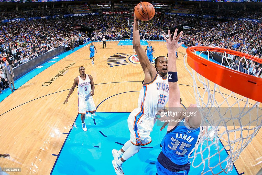 <a gi-track='captionPersonalityLinkClicked' href=/galleries/search?phrase=Kevin+Durant&family=editorial&specificpeople=3847329 ng-click='$event.stopPropagation()'>Kevin Durant</a> #35 of the Oklahoma City Thunder rises for a dunk against <a gi-track='captionPersonalityLinkClicked' href=/galleries/search?phrase=Chris+Kaman&family=editorial&specificpeople=201661 ng-click='$event.stopPropagation()'>Chris Kaman</a> #35 of the Dallas Mavericks on December 27, 2012 at the Chesapeake Energy Arena in Oklahoma City, Oklahoma.