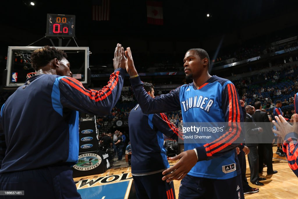 <a gi-track='captionPersonalityLinkClicked' href=/galleries/search?phrase=Kevin+Durant&family=editorial&specificpeople=3847329 ng-click='$event.stopPropagation()'>Kevin Durant</a> #35 of the Oklahoma City Thunder runs out before the game against the Minnesota Timberwolves on November 1, 2013 at Target Center in Minneapolis, Minnesota.
