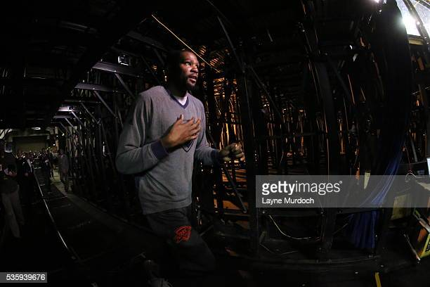 Kevin Durant of the Oklahoma City Thunder runs to the court before the game against the Golden State Warriors in Game Seven of the Western Conference...