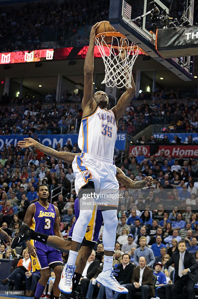 <a gi-track='captionPersonalityLinkClicked' href=/galleries/search?phrase=Kevin+Durant&family=editorial&specificpeople=3847329 ng-click='$event.stopPropagation()'>Kevin Durant</a> #35 of the Oklahoma City Thunder scores against the Los Angeles Lakers December 7, 2012 at Chesapeake Energy Arena in Oklahoma City, Oklahoma. Oklahoma City defeated Los Angeles 114-108.