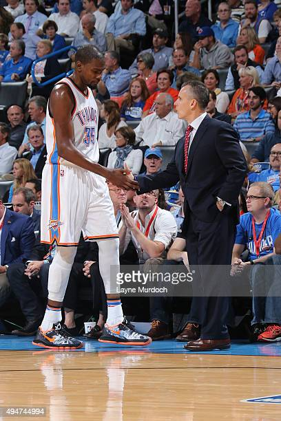 Kevin Durant of the Oklahoma City Thunder shakes hands with Head Coach Billy Donovan of the Oklahoma City Thunder during the game against the San...