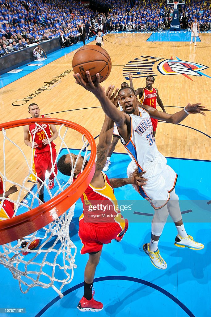 Kevin Durant #35 of the Oklahoma City Thunder shoots a layup against Greg Smith #4 of the Houston Rockets in Game Five of the Western Conference Quarterfinals during the 2013 NBA Playoffs on May 1, 2013 at the Chesapeake Energy Arena in Oklahoma City, Oklahoma.