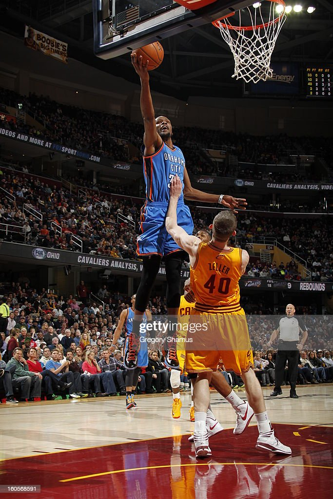 Kevin Durant #35 of the Oklahoma City Thunder shoots a layup against Tyler Zeller #40 of the Cleveland Cavaliers at The Quicken Loans Arena on February 2, 2013 in Cleveland, Ohio.