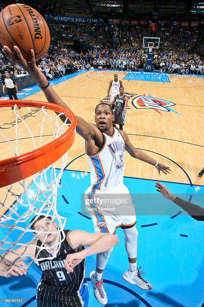 <a gi-track='captionPersonalityLinkClicked' href=/galleries/search?phrase=Kevin+Durant&family=editorial&specificpeople=3847329 ng-click='$event.stopPropagation()'>Kevin Durant</a> #35 of the Oklahoma City Thunder shoots a layup against Nikola Vucevic #9 of the Orlando Magic on March 15, 2013 at the Chesapeake Energy Arena in Oklahoma City, Oklahoma.