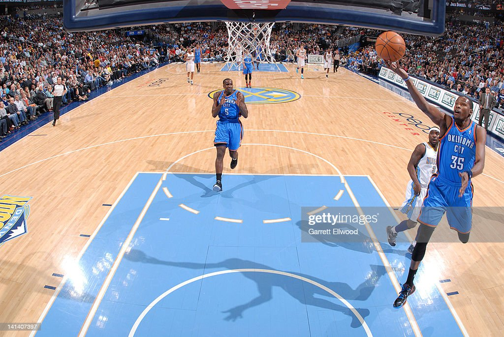 <a gi-track='captionPersonalityLinkClicked' href=/galleries/search?phrase=Kevin+Durant&family=editorial&specificpeople=3847329 ng-click='$event.stopPropagation()'>Kevin Durant</a> #35 of the Oklahoma City Thunder shoots a layup against the Denver Nuggets on March 15, 2012 at the Pepsi Center in Denver, Colorado.
