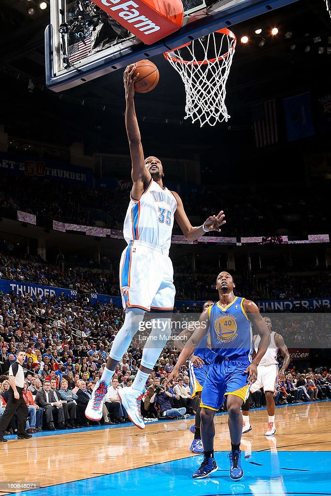 Kevin Durant #35 of the Oklahoma City Thunder shoots a layup against the Golden State Warriors on February 6, 2013 at the Chesapeake Energy Arena in Oklahoma City, Oklahoma.