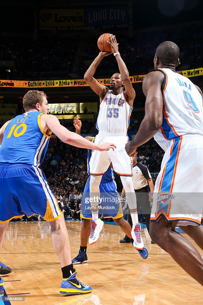 Kevin Durant #35 of the Oklahoma City Thunder shoots against David Lee #10 of the Golden State Warriors on February 6, 2013 at the Chesapeake Energy Arena in Oklahoma City, Oklahoma.