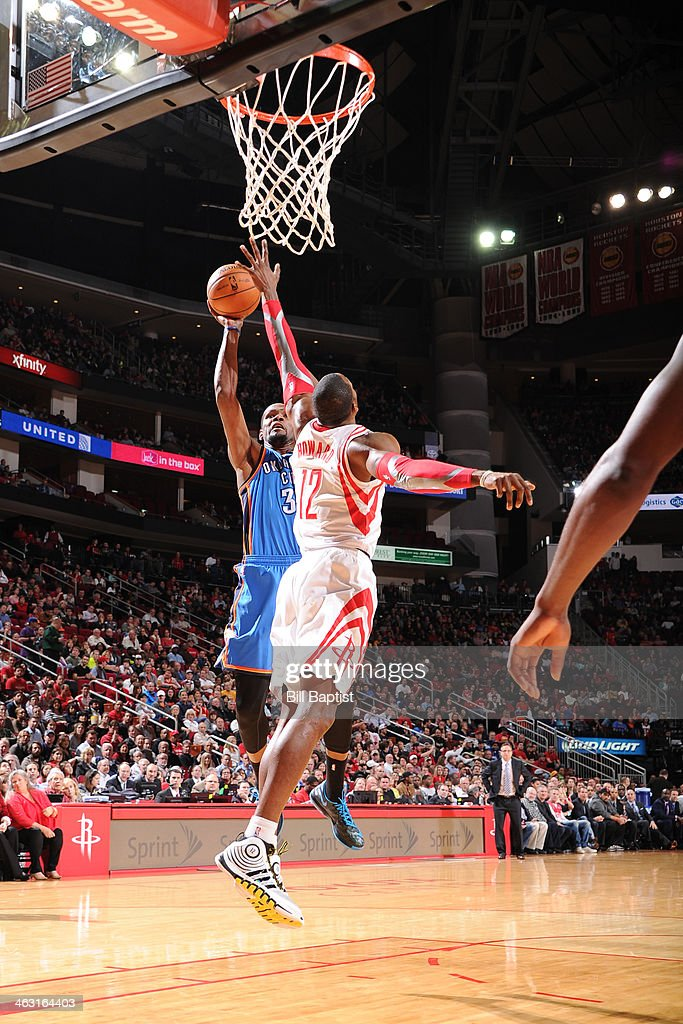 Kevin Durant #35 of the Oklahoma City Thunder shoots against Dwight Howard #12 of the Houston Rockets on January 16, 2014 at the Toyota Center in Houston, Texas.