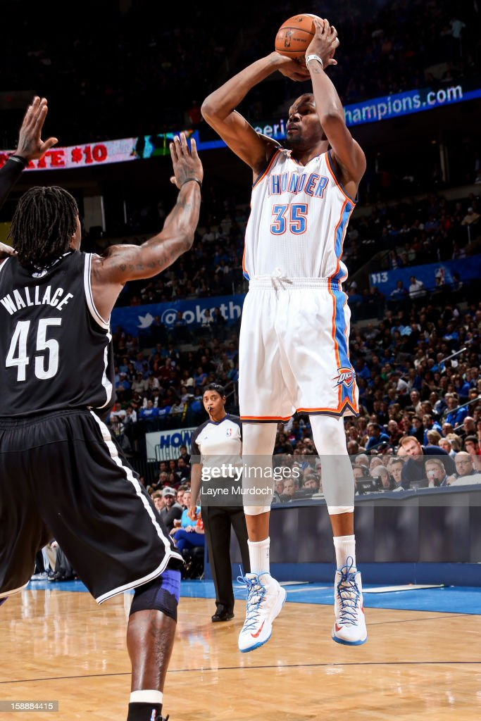 Kevin Durant #35 of the Oklahoma City Thunder shoots against Gerald Wallace #45 of the Brooklyn Nets on January 2, 2013 at the Chesapeake Energy Arena in Oklahoma City, Oklahoma.