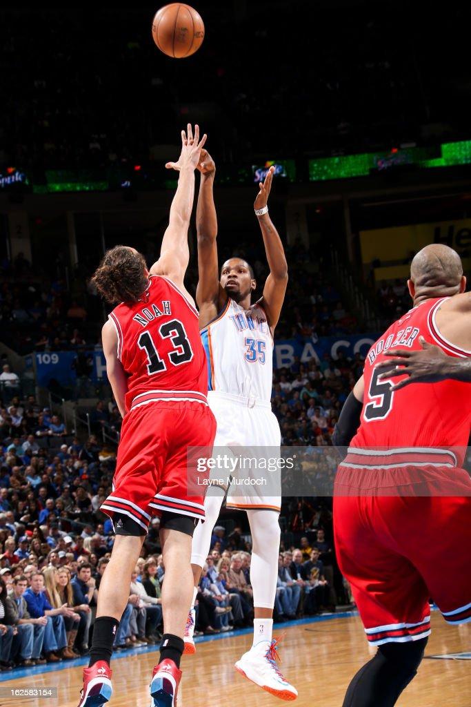 Kevin Durant #35 of the Oklahoma City Thunder shoots against Joakim Noah #13 of the Chicago Bulls on February 24, 2013 at the Chesapeake Energy Arena in Oklahoma City, Oklahoma.