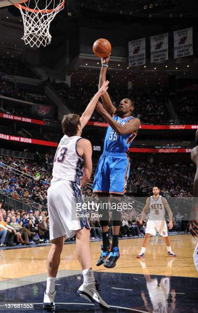 Kevin Durant of the Oklahoma City Thunder shoots against Mehmet Okur of the New Jersey Nets during the game on January 21 2012 at Prudential Center...