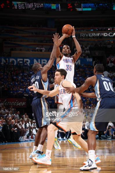 Kevin Durant of the Oklahoma City Thunder shoots against Quincy Pondexter of the Memphis Grizzlies in Game Two of the Western Conference Semifinals...