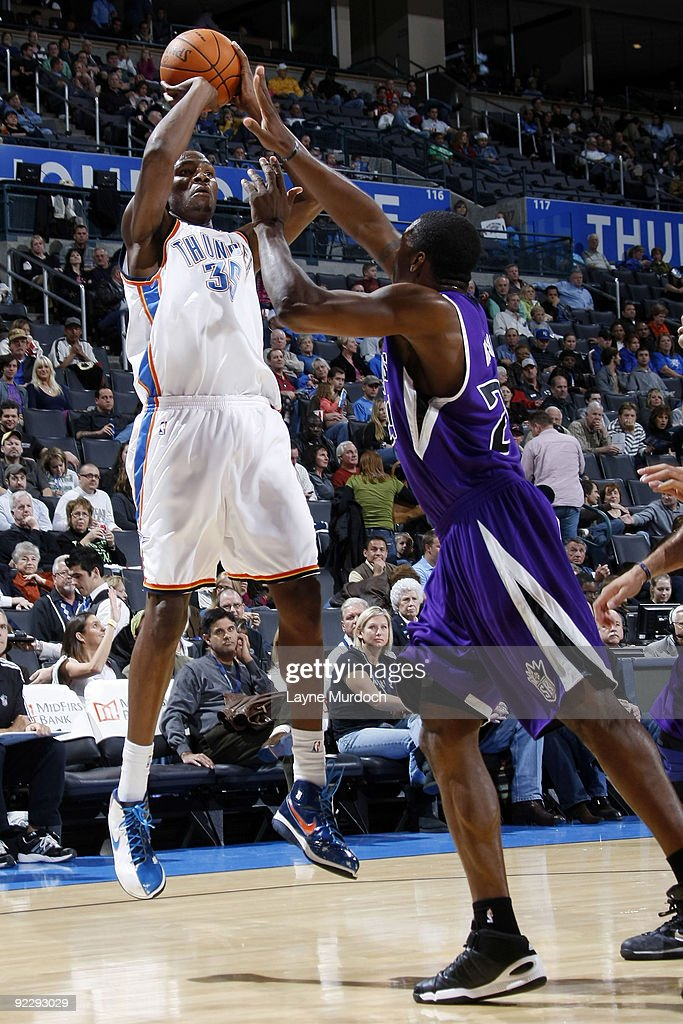 Kevin Durant of the Oklahoma City Thunder shoots over Desmond Mason of the Sacremento Kings on October 22 2009 at the Ford Center in Oklahoma City...