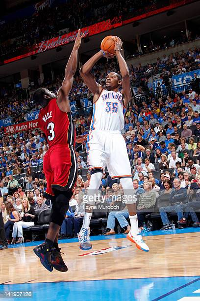 Kevin Durant of the Oklahoma City Thunder shoots over Dwyane Wade of the Miami Heat during the game between the Oklahoma City Thunder and the Miami...